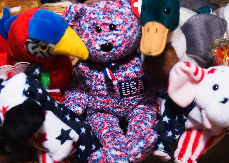 Beanie Babies On Message<br /> 10/28 AM/2006<br /> Gary Fong thing on flash<br /> <br /> For Saturday (now)<br /> I know that the USA is<br /> in focus, soft around the<br /> bear.  I will try it again<br /> if you all think it could <br /> be better.<br /> <br /> Uh, come get my beanie babies, please!<br /> These are kinda rejects that are in a trunk.