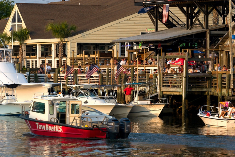 Shem Creek: The Partying Side!<br /> <br /> <br /> (a special request here, from photo below.  It is Red's bar, very popular!  I have never been there.  But it is cool, even has special nights for dogs.)