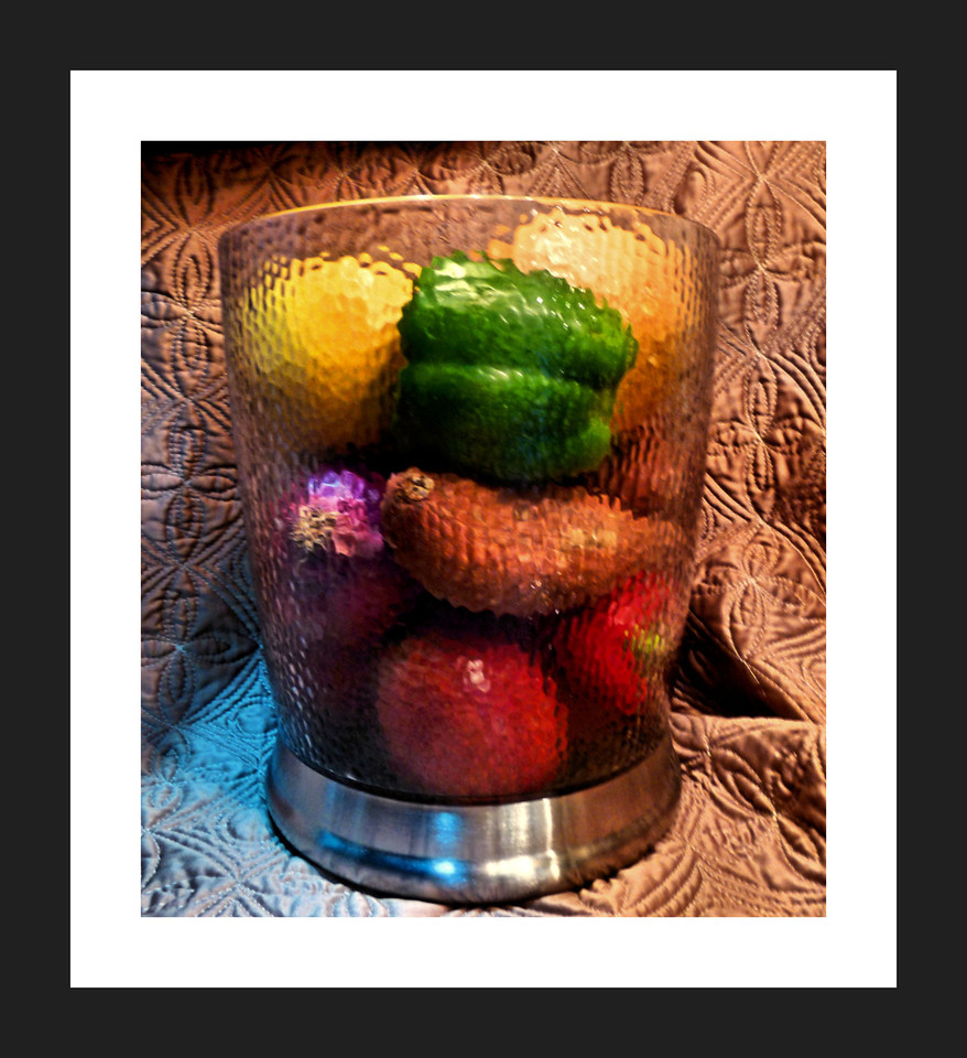 Eight servings a day!<br /> I'm still house sitting so, I had some fun setting up a few little still life arrangements last night. I liked this one best because of all the color, big surprise. <br /> Off for sunrise, to yet another new location for me. Happy Sunday!