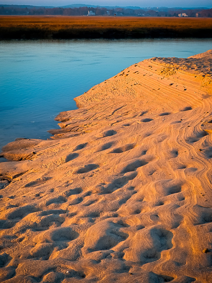 This is a sand bank at the edge of the marsh, just before it opens to the open ocean. I thought the color and patterns in the sand were pretty cool.<br /> <br />  Sunrise<br /> Sandwich, Ma