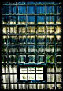 A little abstract fun for your Saturday enjoyment.... This is a giant window at a water treatment plant. The panes of glass are double thick and vertically grooved. It has an interesting mix of reflective and translucent qualities. The top blue is the reflected sky. The golden color is a mix of  inside sunlight and reflected reeds at the water's edge (behind me). They were being illuminated by the setting sun. Then there's blue water and grass and finally the pavement I was standing on. The window is huge and because I was looking up at it, the image had every kind of distortion issue it could possible have. I brought it into lightroom and did the usual things to it but, I also really got to know what the transform tool can do ~miracles!