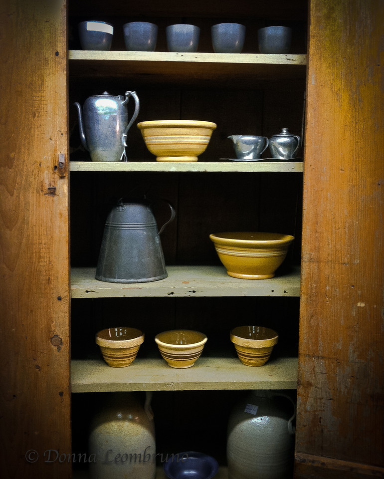I found this old dish cabinet in the antique shop. The lighting was terrible but I loved the textures of the pottery and wood. I made the best of what I had to work with. I wish it would hurry up and snow! I'm getting a little antsy....<br /> I want to thank all of you who take the time to comment on my photos. Myself, I learn a lot from looking at photography other than my own. It's how we learn. So, again, thank you for helping me to continue to grow as a photographer.