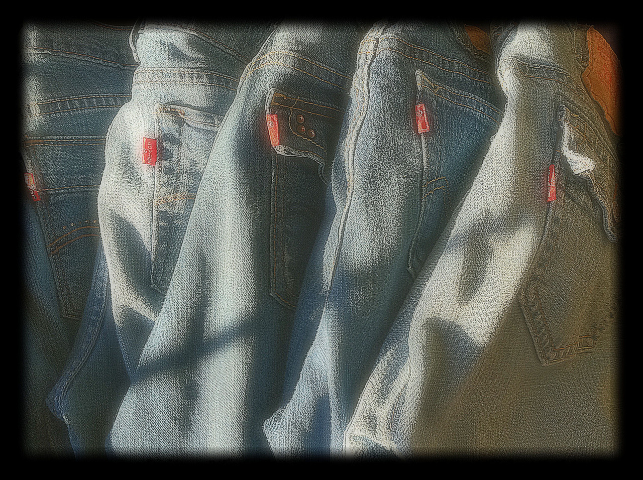 Is there such a thing as too old for Levis?<br />  When I fold my laundry, I always lay my jeans like this. This time though, being in a different house (housesitting), the late afternoon sun was streaming through the window and, well, you know how that goes....I went and got my camera and forgot all about my laundry!