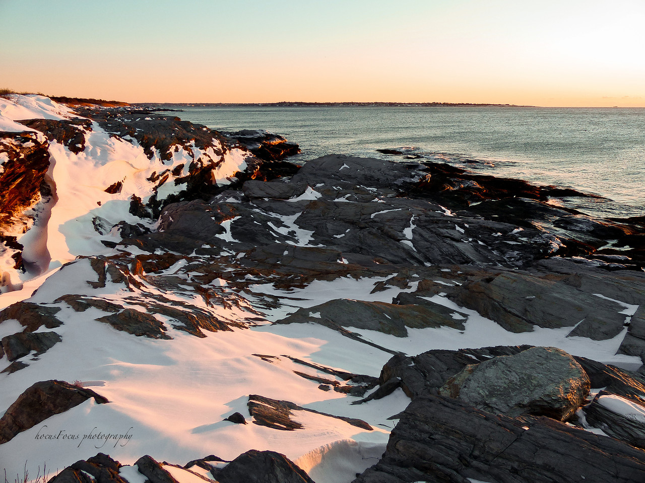 A bitter cold sunrise! It was only 2 degrees and the wind was howling. My fingers were completely numb after only 10 minutes.<br /> <br /> Beavertail State Park<br /> Jamestown, RI