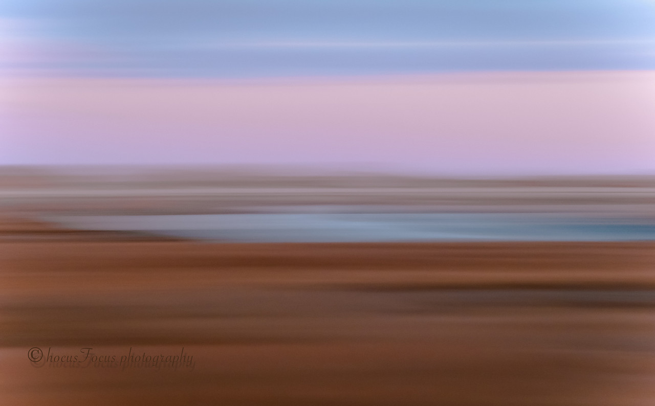 Sandwich Marsh at Sunrise<br /> Cape Cod, Ma<br /> <br /> This was shot pre-sunrise. I created this effect by sweeping the camera back and forth, horizontally, with a slow shutter speed. Sometimes, I end up with dozens of not-so-good attempts before I get the effect I was looking for.