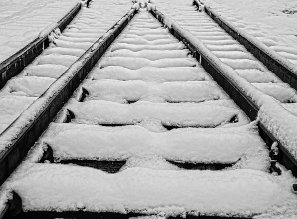 Mar 28 - Snow on the Tracks #1   -  I liked the pattern of lines the tracks and snow created<br /> <br /> Thanks for all the comments on the glass jug in the barn image - they are appreciated very much.