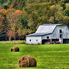 "Oct 23 - Country Fall in West Virginia #2<br /> <br /> This photo is another image of the scene I posted in my Daily Gallery on Oct 10, hence the ""#2"" in the caption.  I love the freshly mowed green hay field against the white barn with the fall colors on the trees in the background.  I think the red tractor is a plus also."