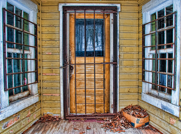 Mar 13 - Locked In or Locked Out?  I loved these colors and bars against the door and windows on this old little porch.  The box of leaves was a plus in my opinion.<br /> <br /> Thanks for your comments on my rusty discs abstract.  You all inspire me with your images!