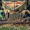 May 29 - Metal Mean Face<br /> <br /> The front of this old rusty truck resembles someone who has a mean looking face to me.