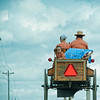 "Sept 12 - Amish Family<br /> <br /> There are two little girls in the back of the wagon, but  one was playing with her blue blanket in the wind.  I was taking the picture through the windshield while my husband was driving and the little girl never put the blanket down. <br /> <br />  The wagon was at the top of a hill about to go down the other side.  My vantage point was from the passenger side of a truck behind and below them on the hill.  This is why the wagon appears ""to be high"".  I couldn't get the road in the shot because the truck's dash and hood was in the way.<br /> <br /> This was taken in Ohio around Millersburg, Charm, and Sugar Creek area.  I live about 2 hours away.<br /> <br /> Thanks so much for all your comments on the Amish images I have been posting these past few days!"