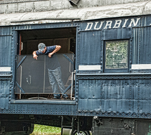 """July 10 - Checking out the tracks<br /> <br /> This is a worker on the tourist train, The Durbin Rocket.  He is making sure everything is ready for the tourists to board.  The train will take tourists for a ride along the Greenbrier River in Durbin, West Virginia.  Yesterday I posted an image of the engine which can be found here: <a href=""""http://www.jmannimages.com/Photography/Daily-Photos/Daily-2013/27709097_kNKbMC#!i=2622852979&k=kWJBr9T"""">http://www.jmannimages.com/Photography/Daily-Photos/Daily-2013/27709097_kNKbMC#!i=2622852979&k=kWJBr9T</a><br /> <br /> Thanks so much for all your kind comments on the engine image, Old #3, I posted yesterday!  It truly is a beautiful machine!"""