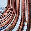 Mar 29 - These are the curved metal forks from a landscaping rake against a snow covered ground.  I liked the curved pattern they made.<br /> <br /> Thanks for the comments on my railroad tracks and snow image - they are greatly appreciated expecially coming from a group that consistently creates fantastic images!