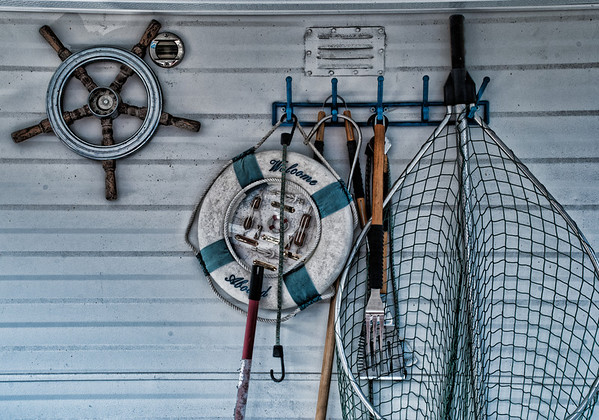 """April 6 - Must Have Houseboad Essentials - saw these things hanging up on the """"porch"""" of the houseboat in my earlier pictures.  The barbecue utensils may be the most important amount all of them."""