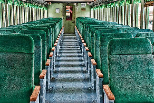 April 9 - This is looking down the aisle of the inside of a tourist train car.