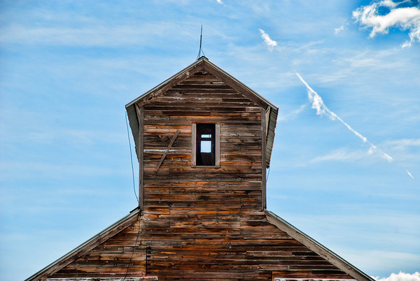 Aug 6 - Reach For the Sky<br /> <br /> This is the top of an old grain elevator in Montana.  Most of the one you see are metal, but I like this one because of the wood and the tones of the wood against the sky.<br /> <br /> I haven't posted for a few days!  I am trying to work on my new smugmug plus busy with other stuff!  I am posting this (I hope) from my new layout - hopefully it works!