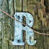 "May 18 - The Letter ""R"" for the daily community Sunday challenge<br /> <br /> I found it very difficult to find something in the shape of the letter ""R""!  So this is probably cheating a little - I saw this on an old electric pole that was laying in a field.<br /> <br /> I didn't post an image yesterday, so I would like to thank everyone for all the comments on my Morning Light at Mammoth Hot Springs image I posted Friday - they are all appreciated!!"
