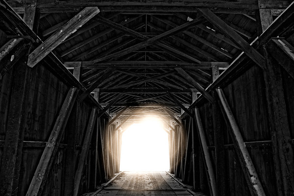 "Feb 3 - Light  At The End of The Tunnel<br /> <br /> This is the inside structure of a covered bridge -   I played around with processing to add the ""light"" at the end.  The white you see on the wooden beams is snow that the wind blew in.  The same image without the ""light"" at the end can be found here:  <a href=""http://www.jmannimages.com/Black-and-White/i-7xVb52m/A"">http://www.jmannimages.com/Black-and-White/i-7xVb52m/A</a>"