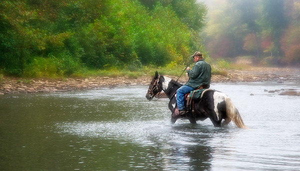 """April 1 - Riding Across<br /> <br /> This is an image of my husband during a trail ride.  It was taken in the early morning light on his horse named """"Storm"""".<br /> <br /> Thanks so much for your kind comments on my elk image yesterday.  They are very much appreciated."""