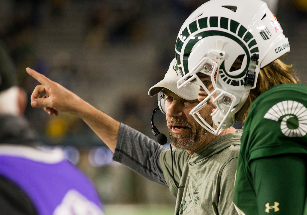 . Colorado State head coach Mike Bobo gives direction to quarterback Collin Hill (15) late in the game against Wyoming Friday evening Oct., 26 2018 at Canvas Stadium in Fort Collins. The Rams fell 34-21. (Michael Brian/For the Reporter-Herald)