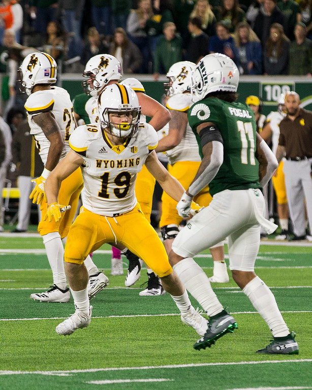 . Wyoming wide receiver Ayden Eberhardt (19), from Loveland, Colo., prepares to block Colorado State safety Jordan Fogal (11) Friday evening Oct., 26 2018 at Canvas Stadium in Fort Collins. (Michael Brian/For the Reporter-Herald)