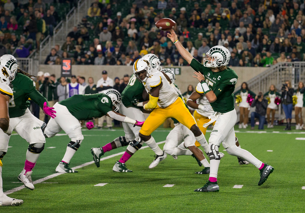 . Colorado State starting quarterback Collin Hill (15) throws against Wyoming Friday evening Oct., 26 2018 at Canvas Stadium in Fort Collins. (Michael Brian/For the Reporter-Herald)