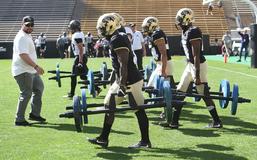 . Klayton Adams watches players go through drills during the CU Spring football festivities on Saturday.  Cliff Grassmick  Photographer  March 17, 2018
