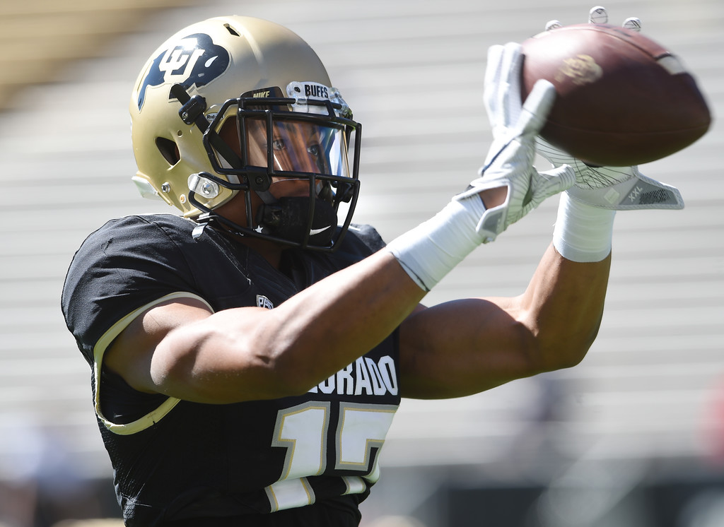 . Kabion Ento doing drills during the CU Spring football festivities on Saturday.  Cliff Grassmick  Photographer  March 17, 2018