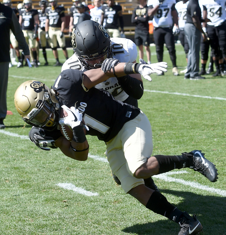 . Dante Sparaco tackles Donovan Lee during the CU Spring football festivities on Saturday.  Cliff Grassmick  Photographer  March 17, 2018