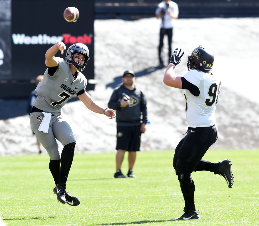 . Tyler Lytle passes over Nico Magri during the CU Spring football festivities on Saturday.  Cliff Grassmick  Photographer  March 17, 2018