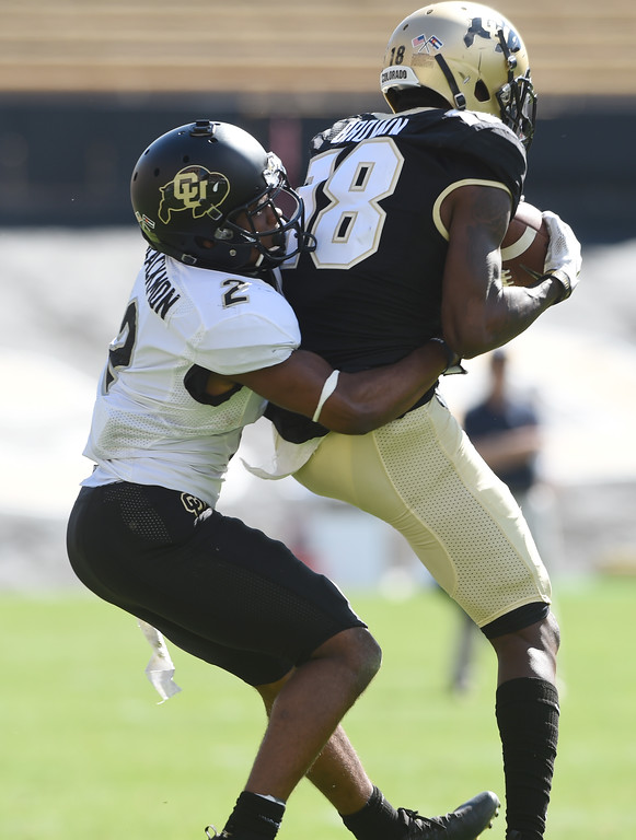 . Tony Brown makes a catch in front of Ronnie Blackmon during the CU Spring football festivities on Saturday.  Cliff Grassmick  Photographer  March 17, 2018