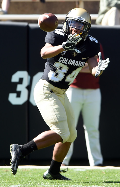 . Noa Lukela makes a catch during the CU Spring football festivities on Saturday.  Cliff Grassmick  Photographer  March 17, 2018