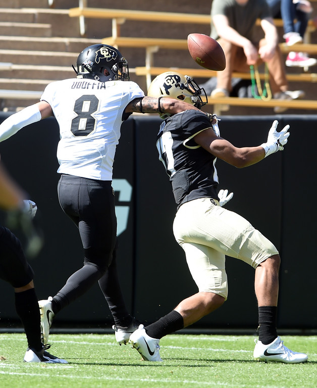 . Kabion Ento makes one of his TD catches over Trey Udoffia during the CU Spring football festivities on Saturday.  Cliff Grassmick  Photographer  March 17, 2018