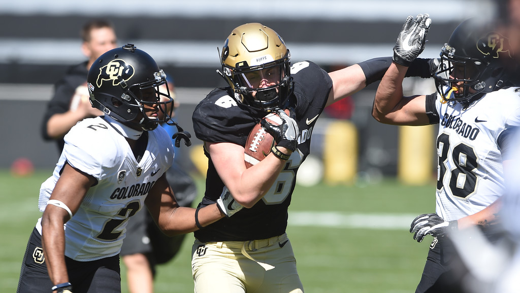 . Curtis Chiaverini, center, in a ball control drill during the CU Spring football festivities on Saturday.  Cliff Grassmick  Photographer  March 17, 2018