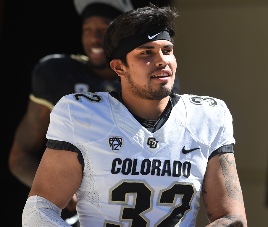 . Rick Gamboa comes out of the tunnel during the CU Spring football festivities on Saturday.  Cliff Grassmick  Photographer  March 17, 2018