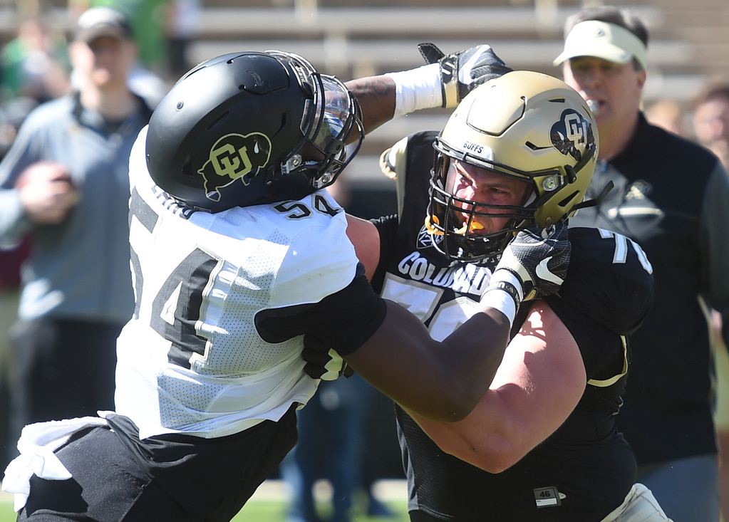 . Terrance Lang, left, an Jake Moretti, battle during a drill at  the CU Spring football festivities on Saturday.  Cliff Grassmick  Photographer  March 17, 2018