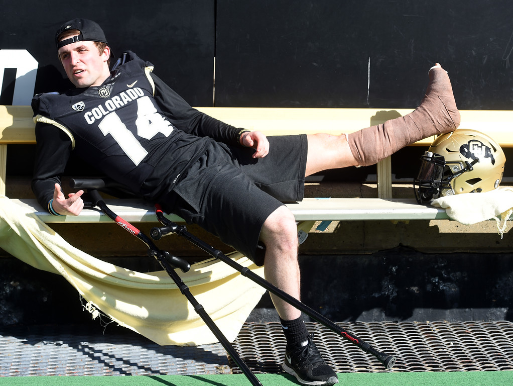 . Jay MacIntyre keeps his leg elevated during the CU Spring football festivities on Saturday.  Cliff Grassmick  Photographer  March 17, 2018