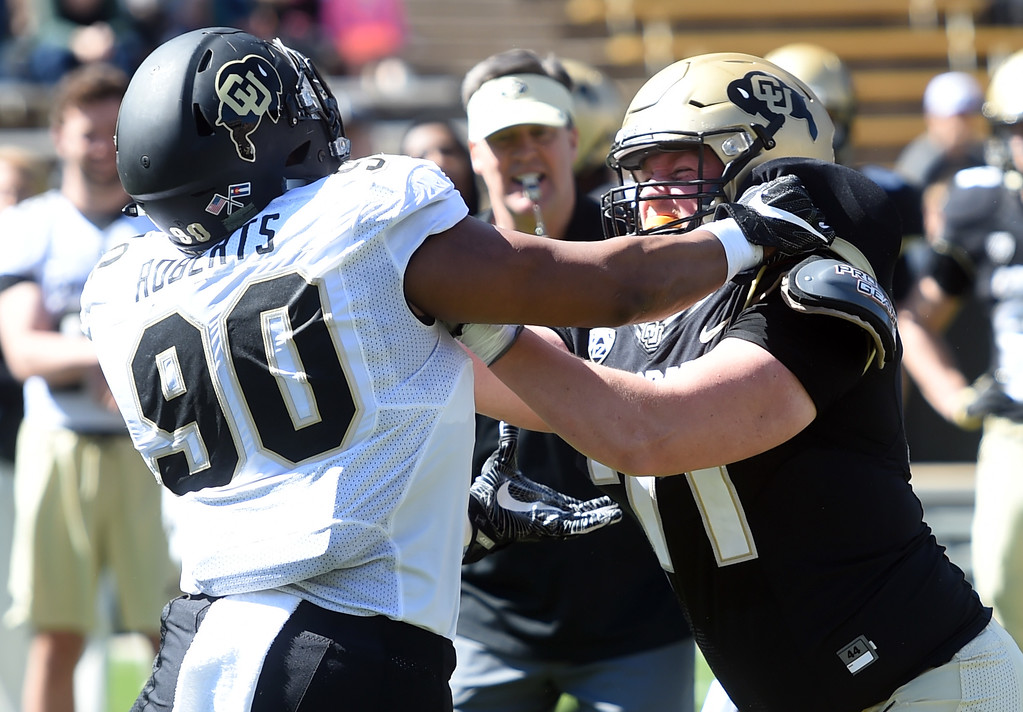 . Terriek Roberts, left, and Jack Shutack go at it during the CU Spring football festivities on Saturday.  Cliff Grassmick  Photographer  March 17, 2018