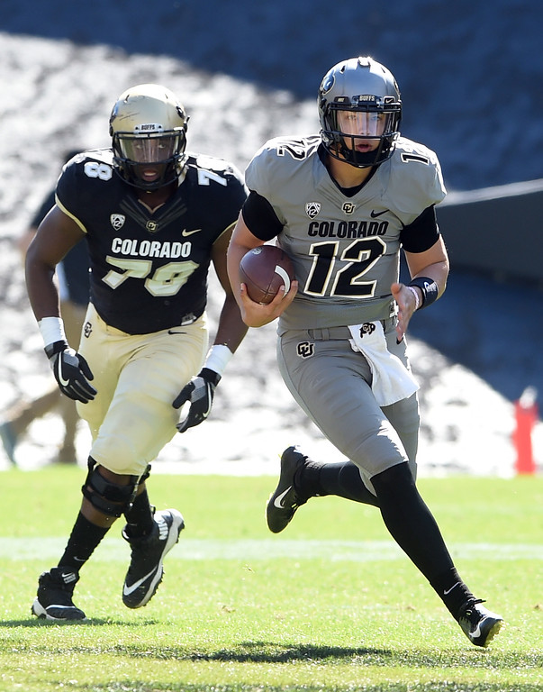 . Steven Montez breaks out on a run during the CU Spring football festivities on Saturday.  Cliff Grassmick  Photographer  March 17, 2018