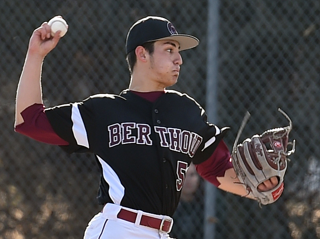 . Berthoud\'s (5) Chris DeSousa pithes during their game against D\'Evelyn Tuesday, March 13, 2018, at Berthoud High School. (Photo by Jenny Sparks/Loveland Reporter-Herald)