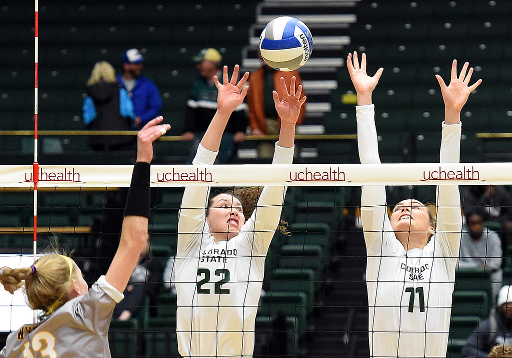 . Colorado State\'s Katie Oleksak and Paulina Hougaard-Jensen block a shot by Wyoming\'s Emily Lewis during their game on Tuesday, Oct. 30, 2018, at Moby Arena in Fort Collins.  (Photo by Jenny Sparks/Loveland Reporter-Herald)
