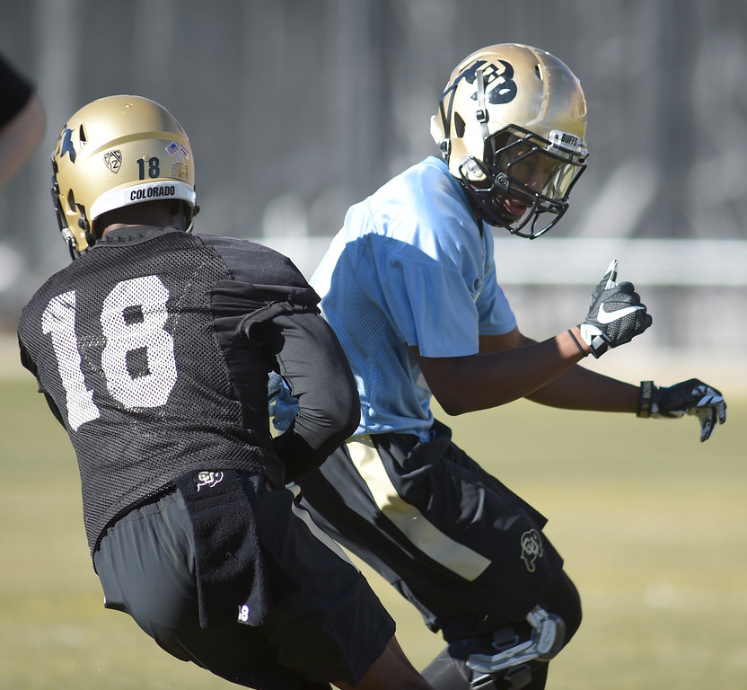 . Lee Walker, left, and Jaylon Jackson, work on a drill during the first day of Spring football at the University of Colorado. For more photos, go to www.buffzone.com. Cliff Grassmick  Staff Photographer  February 22, 2017