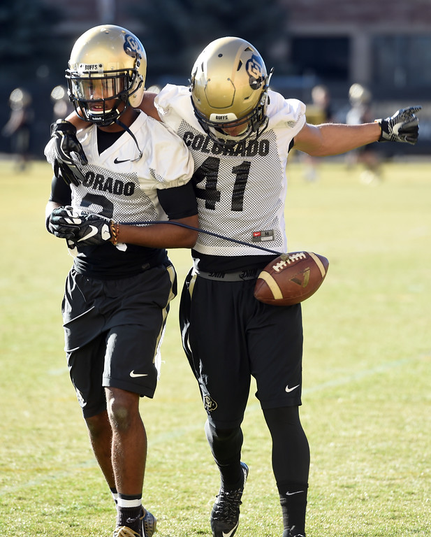 . Ronnie Blackmon, left, and Andrew Bergner go through defensive back drills during the first day of Spring football at the University of Colorado. For more photos, go to www.buffzone.com. Cliff Grassmick  Staff Photographer  February 22, 2017