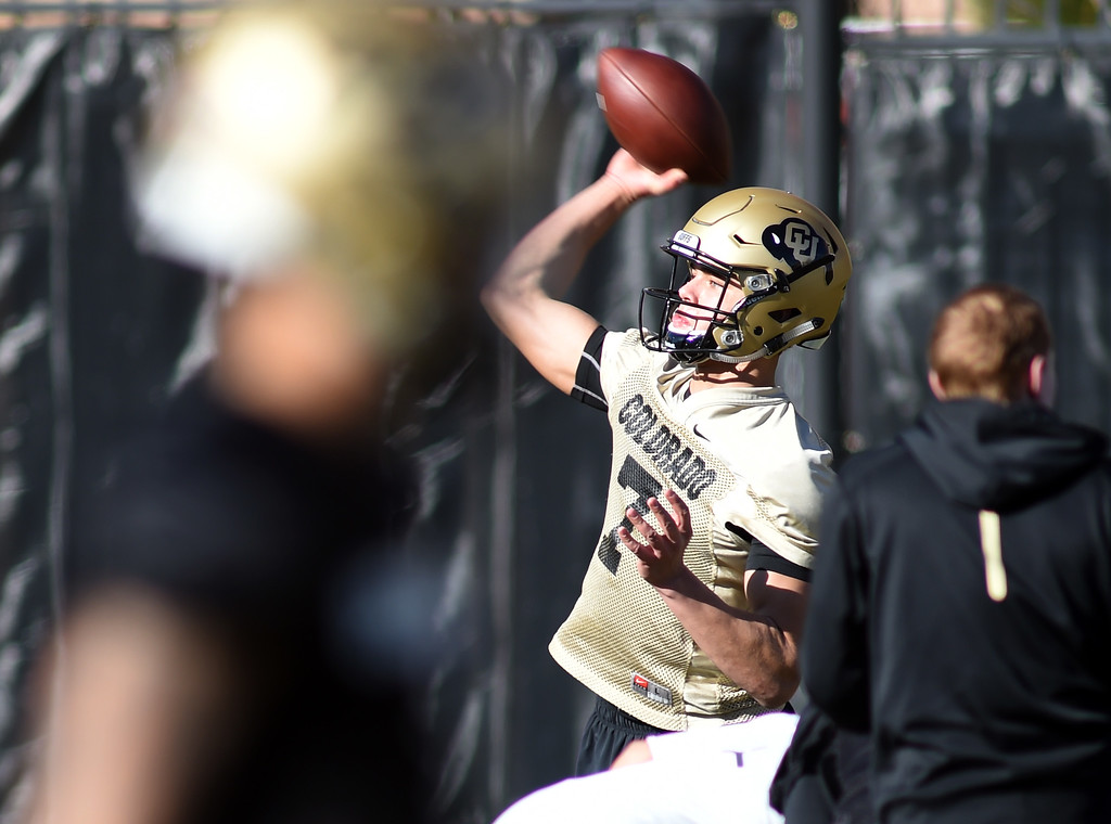 . Freshman Tyler Lytle goes through quarterback drills during the first day of Spring football at the University of Colorado. For more photos, go to www.buffzone.com. Cliff Grassmick  Staff Photographer  February 22, 2017