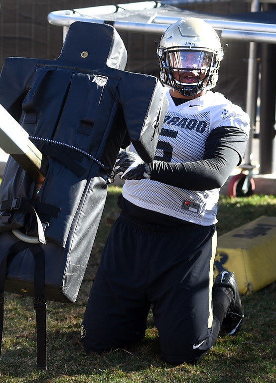 . George Frazier finishes up on the sled during the first day of Spring football at the University of Colorado. For more photos, go to www.buffzone.com. Cliff Grassmick  Staff Photographer  February 22, 2017
