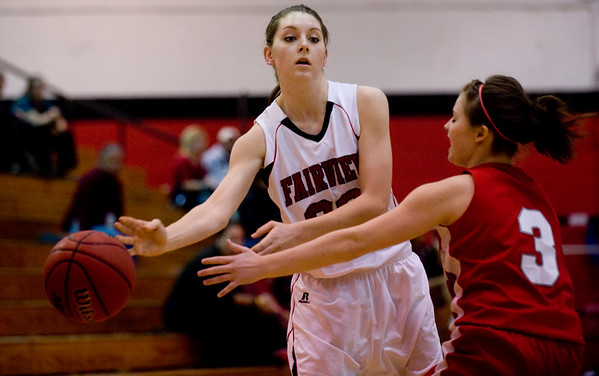 Fairview's Caitlin Higgins (right) passes around Brighton's Jordanne Kniss during their game at Fairview High School in Boulder, Jan. 14, 2009. <br /> KASIA BROUSSALIAN