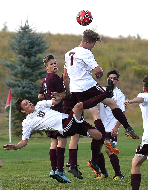 . Berthoud\'s Conrad Ellis hits a header as Caden Grimditch tries to back him up during their game against Loveland Classical Tuesday, Sept. 4, 2018, at Mehafey Park in Loveland. (Photo by Jenny Sparks/Loveland Reporter-Herald)