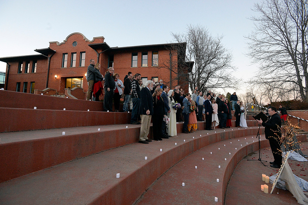 . Brides and grooms gather for a group wedding ceremony Wednesday, Feb. 14, 2018, at Foote Lagoon in downtown Loveland. Eleven couples married and 12 renewed their vows. (Photo by Jenny Sparks/Loveland Reporter-Herald)