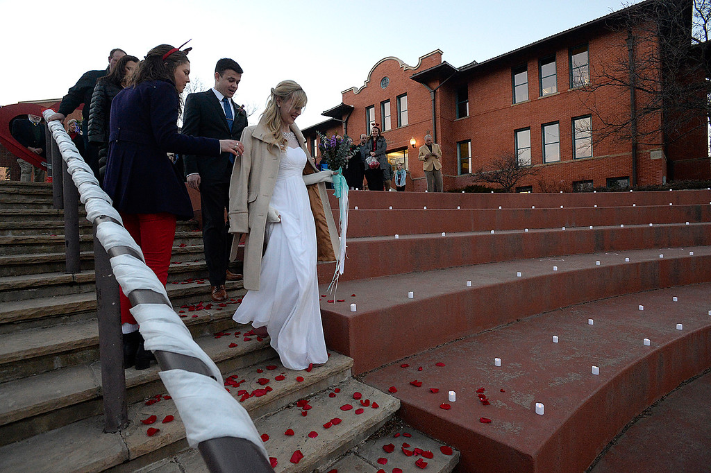 . Megan Plesscher and her groom, Thomas Whittington, both of Loveland,  walk down the aisle with a group of other brides and grooms during a group wedding ceremony Wednesday, Feb. 14, 2018, at Foote Lagoon in downtown Loveland. Eleven couples married and 12 renewed their vows. (Photo by Jenny Sparks/Loveland Reporter-Herald)