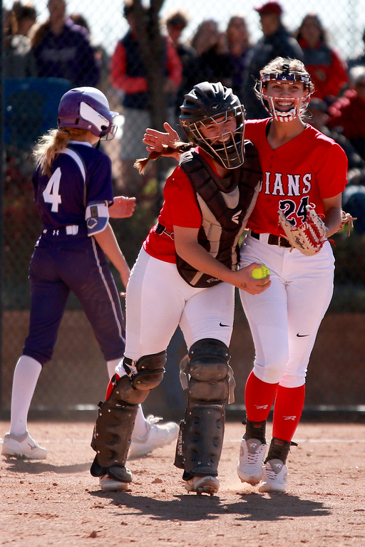 . Loveland�s Elena Gerhard (2) and Laurin Krings (24) hug in celebration at their game against Arvada West at the state championships for high school softball at Aurora Sports Park on Oct. 19, 2018 in Aurora. Photo by Taelyn Livingston/ Loveland Reporter-Herald