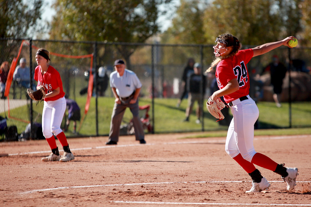 . Loveland�s (24) Laurin Krings winds up her pitch as teammate (10) Sage Baldwin plays third base at their game against Arvada West at the state championships for high school softball at Aurora Sports Park on Oct. 19, 2018 in Aurora, Colo. Photo by Taelyn Livingston/ Loveland Reporter-Herald